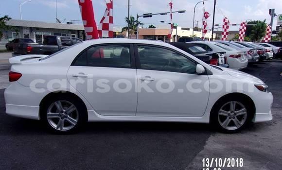 Buy Import Toyota Corolla White Car in Kigali in Rwanda